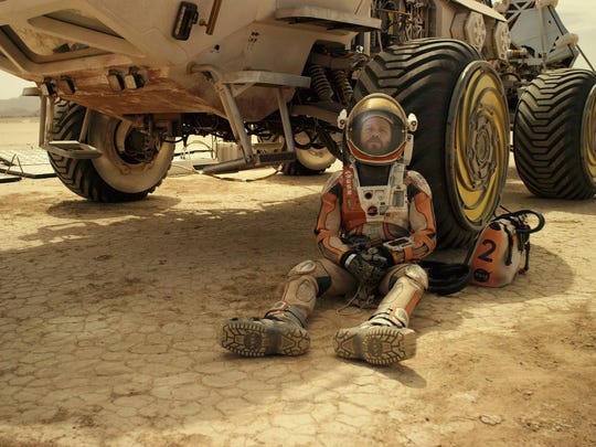 """This photo released by 20th Century Fox shows Matt Damon in a scene from the film, """"The Martian."""""""