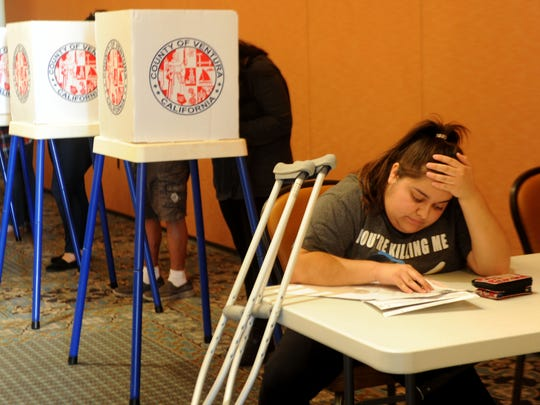 Michelle Pena sits to vote at the Camarillo Library on Tuesday.