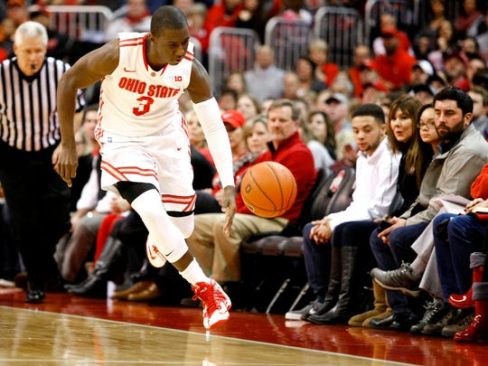 Ohio State guard Shannon Scott (3) toes the out of bounds line after a steal as the Buckeyes pull away in the second half versus the Illinois Fighting Illini at Value City Arena. Ohio State won 77-61.