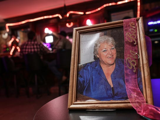 A photo on display of the late Bonnie Storti, who founded