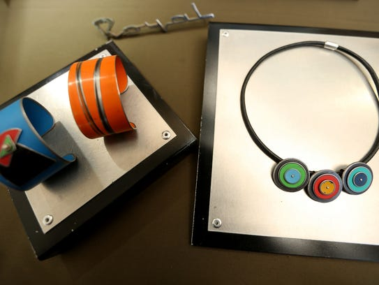 Jewelry made with parts of vintage cars and their original