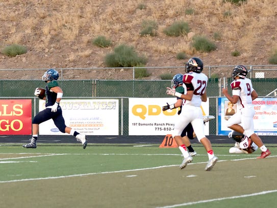 Damonte's Dru Jacobs runs for a score against Northgate