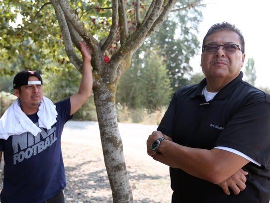 Ramon Ramirez, right, the president of PCUN: Pineros