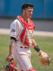 Bombers catcher Niko Pacheco walks back to the dugout during a recent game at C.O. Brown Stadium.