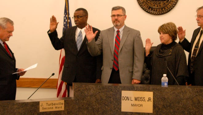 Councilpersons Dwight Haynes, Robby Harmon, Betty Lou Alsobrooks and Horace Perkins III take the oath of office Monday evening at City Hall.