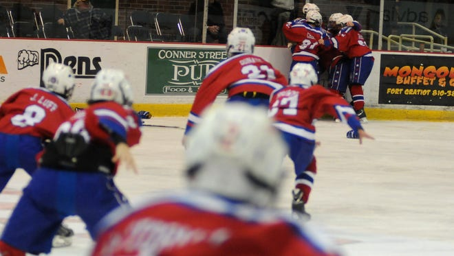 The New Jersey Colonials celebrate after scoring in overtime to win Sunday, Jan. 10, during the PeeWee AAA Championship at the Silver Stick Finals in Port Huron.