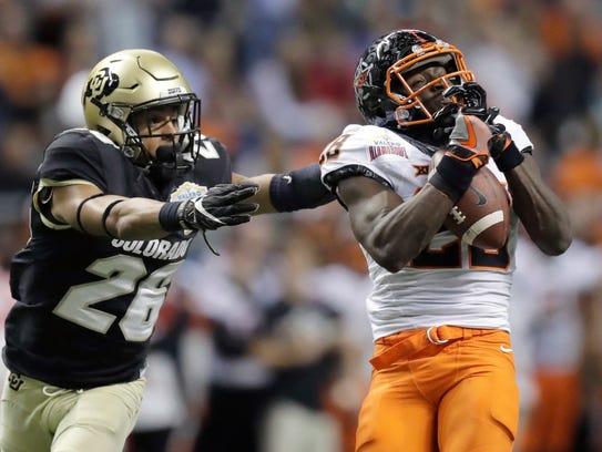 Oklahoma State wide receiver James Washington (28)