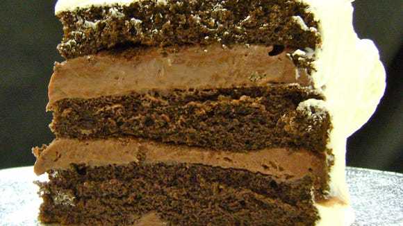 Readers love the triple-layer, custard-filled cakes turned out by little Lisa's Rum Cake in Gilbert so much that their votes pushed Oregano's pizza cookie off the top of the Best Dessert list for 2011. This is a slice of the Òchocolate chocolateÓ rum cake. cr: lisasrumcake.com.