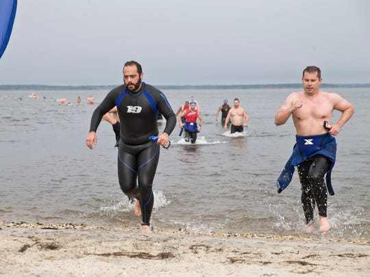 Athletes compete in a triathlon throughout a small