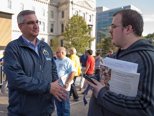 Eric Holcomb, the Republican candidate for Indiana governor, greets Wesley Crouch, of Westfield, after the Hoosier Homecoming bicentennial celebration at the Indiana Statehouse in Indianapolis, Oct. 15, 2016.