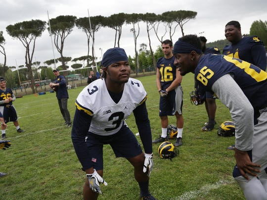Michigan defensive lineman Rashan Gary, center gets ready to catch a football as the Wolverines wrap up their first day of practice in Rome at Giulio Onesti Training Center on Thursday, April 27, 2017.