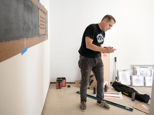 """Shepard Fairey listened to music by punk band the Misfits while setting up his show this week at the Cranbrook Art Museum. The exhibit is """"not only framed pieces,"""" says Fairey. """"There's also a lot of different pieces of ephemera that show process."""""""