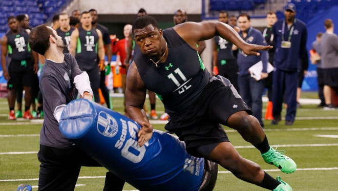 Feb 28, 2016; Indianapolis, IN, USA; UCLA Bruins defensive lineman Kenny Clark participates in the workout drills during the 2016 NFL Scouting Combine at Lucas Oil Stadium.