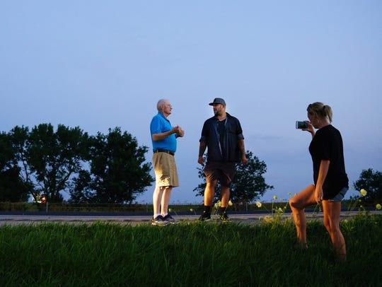 State Trooper Charlie Black, left, reunites with John