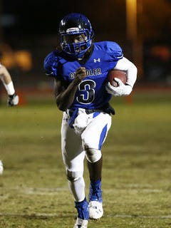 Chandler quarterback Bryce Perkins runs for a first down against rival Chandler Hamilton  on Nov. 25, 2013, in a Div. I semifinal playoff game.