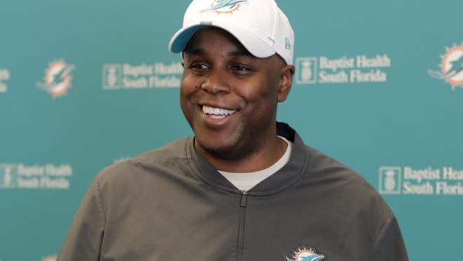 Miami Dolphins general manager Chris Grier speaks during a news conference.