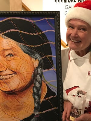 Bird Thomas was presented the Community Builder Award and a portrait Thursday.