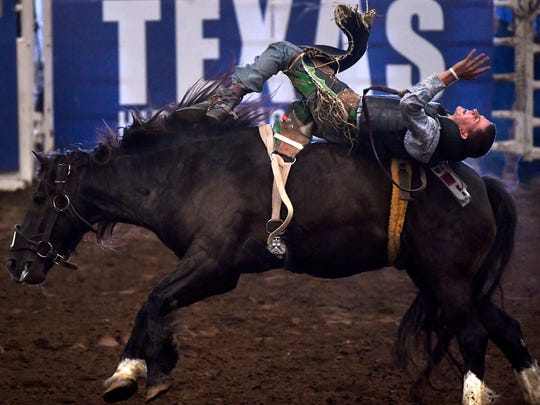 J.D. Spivey of Haslet tries to remain on top during the bareback riding at the 2018 Texas High School Rodeo Association Finals.