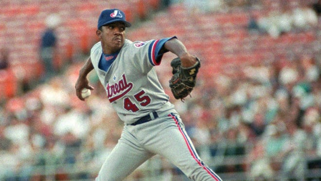 Montreal Expos' pitcher Pedro Martinez delivers a pitch during the first inning of their game Friday May 17, 1996 in San Diego. Martinez allowed only one run and three hits in the first eight innings of the game.