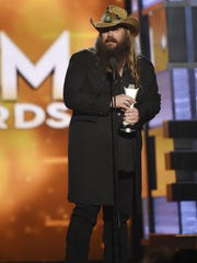 Chris Stapleton gives a speech after winning the male