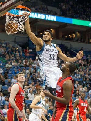 Apr 13, 2016; Minneapolis, MN, USA; Minnesota Timberwolves center Karl-Anthony Towns (32) dunks the ball in the second half against the New Orleans Pelicans at Target Center. The Timberwolves won 144-109. Mandatory Credit: Jesse Johnson-USA TODAY Sports