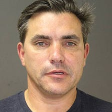 This photo provided by the Southampton Town Police Department on Long Island shows celebrity chef Todd English, 54, after his arrest early Sunday morning, Aug 31, 2014 in Southampton, N.Y., where he was charged with driving while intoxicated.