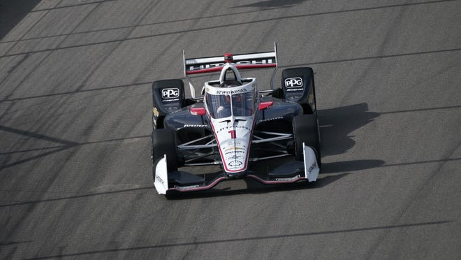 Josef Newgarden drives into Turn 1 during the IndyCar auto race at World Wide Technology Raceway on Sunday in Madison, Ill.