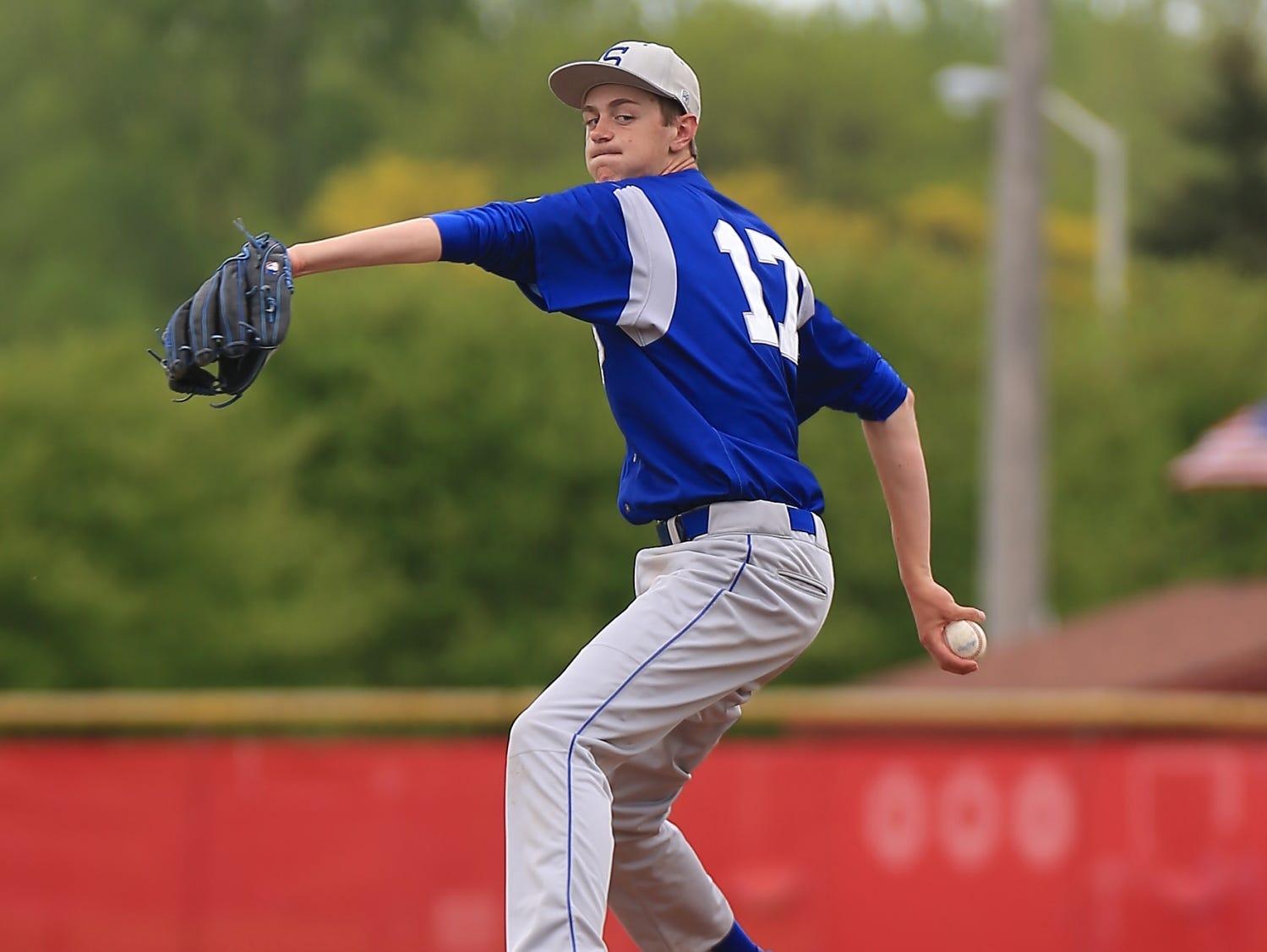 Salem pitcher Eric Scott delivers the baseball toward a Canton batter on Thursday.