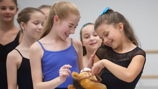 Claire Smith, 10, of Swedesboro (right) dances the part of Marie, shown here with classmate Sophia Forchetti (in blue), 11, of Philadelphia, during rehearsal for 'The Nutcracker' at the Pennsylvania Ballet School rehearsal studio in Philadelphia.