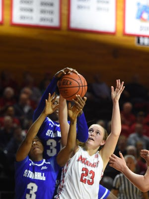 Marist's Rebekah Hand guarded by Seton Hall's defenders on Nov. 15. On Monday, Hand was named the MAAC Rookie of the Week for the second week in a row.