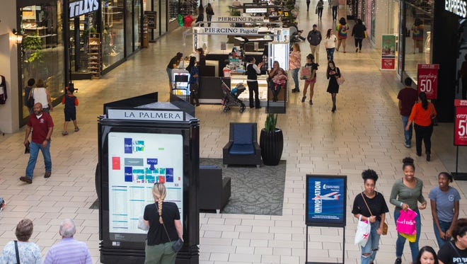 People shop at the the La Palmera mall Tuesday, Nov. 21, 2017.