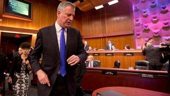 New York City Mayor Bill de Blasio arrives to testify