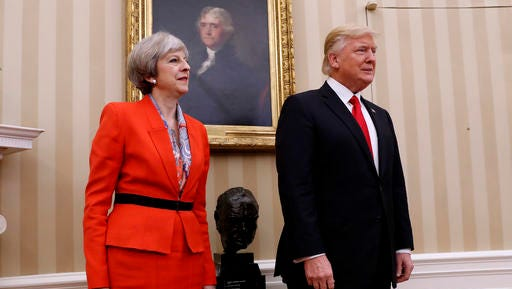 President Donald Trump stands with British Prime Minister Theresa May, Friday, Jan. 27, 2017, in the Oval Office of the White House in Washington.