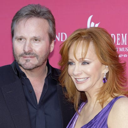Reba McEntire, left, and husband Narvel Blackstock