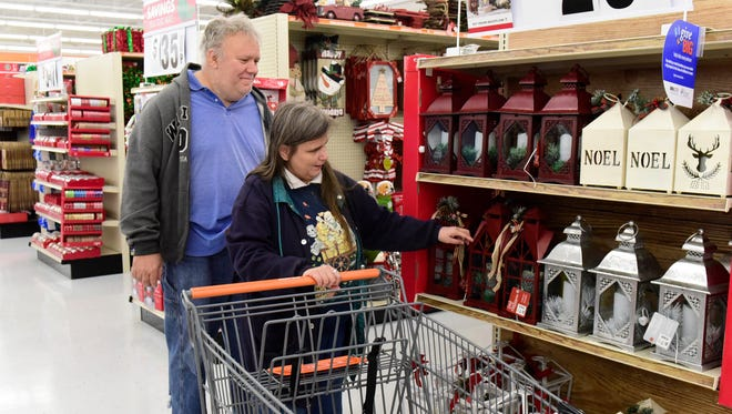 Fred and Jennifer and Keler of Gibsonburg shop at Big Lots in Fremont before the store's official grand opening on Friday.
