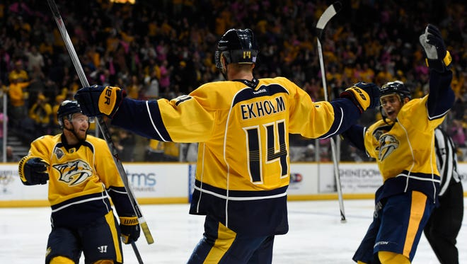 Predators teammates congratulate Predators defenseman Mattias Ekholm (14) after his goal in the third period Thursday.