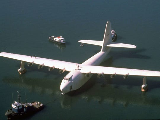 "In this Oct. 29, 1980 file photo, Howard Hughes' wooden flying boat the ""Spruce Goose,"" is towed by a tugboat in Long Beach."