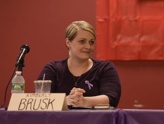 Kimberly Brusk, Co-founder of Women Against the Violence Epidemic, and a survivor of domestic violence speaks during a forum in Oradell on gun violence as a women's issue on Saturday.