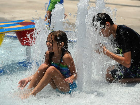 Kids play in the fountains at Adventure Cove on June
