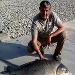 Bowfisherman John Overstreet shot his record 54-pound largemouth buffalo at Pomme de Terre Lake..
