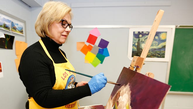 Deena Petrino from Pearl River finishes her painting during an art class at the Clarkstown Learning Center in Congers on Friday, March 31, 2017.