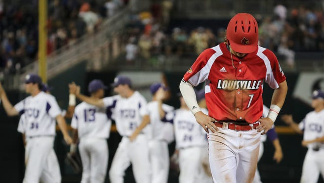U of L's Devin Mann (7) was dejected in the foreground as TCU celebrated in the background after being forced out at 2nd base to end their College World Series run in Omaha, Neb.  