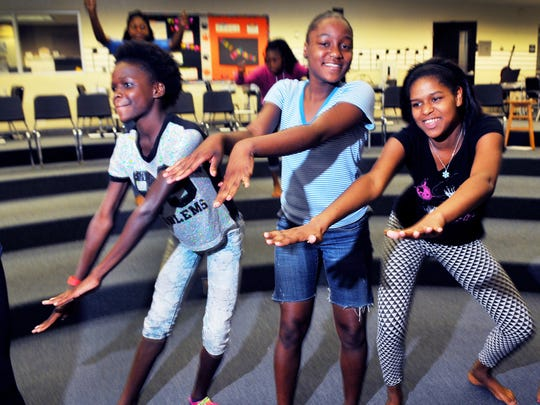 De'yanna Knowles age 12,Tamaria Cooper age 14 and Makasha Hall age 17  all of Cocoa rehearse a dance to Waging War by CeCe Winans during one of the programs with the Central Florida YMCA after school program held at Cocoa High.