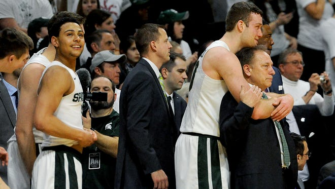 MSU coach Tom Izzo, right, has never been more fond of a group of players than this year's team, including Matt Costello (hugging him) and Bryn Forbes, left. His biggest regret in losing early in the NCAA tournament is that he won't get to coach them longer.