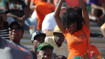 Fans cheer on Florida A&M University's football team Saturday. FAMU beat Delaware State University 43-13 in a homecoming game at Bragg Stadium. It was FAMU's first win this season after losing six straight games.