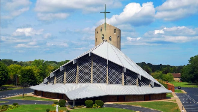 St. John the Evangelist Church's current site on West Ridge Road is a distinctive structure.