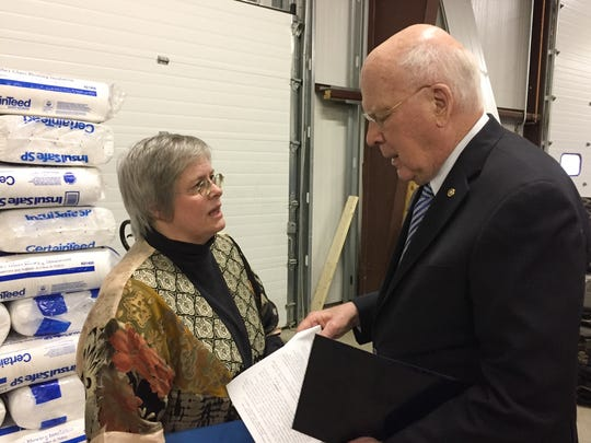 Sen. Patrick Leahy, D-Vt., right, speaks with Jan Demers, executive director of the Champlain Valley Office of Economic Opportunity, following a news conference Monday in Colchester.