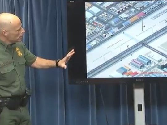 CBP Deputy Commissioner Ronald Vitello shows a rendering of concrete fences at  a news conference on Aug. 31, 2017.