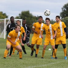 It's a scrum for the ball between Schoolcraft College and Cincinnati State men's soccer players during Saturday's contest.