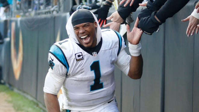 Carolina Panthers quarterback Cam Newton (1) celebrates with fans after defeating the Seattle Seahawks 31-24 in the NFC divisional playoffs.